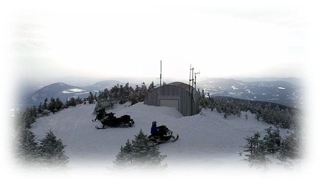 Snowmobiles mountaintop